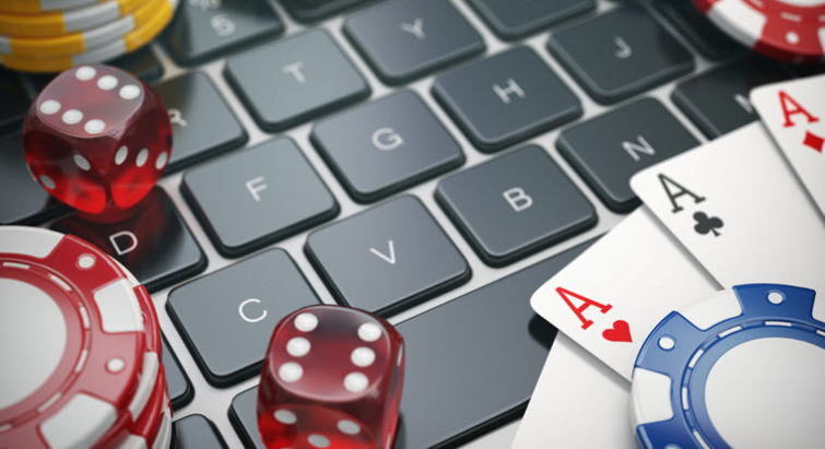 cards and dice on a keyboard